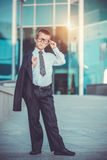 Kid businessman on the blue modern background Stock Photography