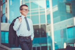 Kid businessman on the blue modern background Royalty Free Stock Photography
