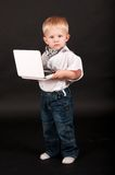 Kid businessman with a laptop Royalty Free Stock Image