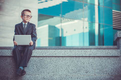 Kid businessman with laptop Royalty Free Stock Images