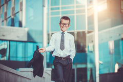 Kid businessman is waving his jacket Stock Photography