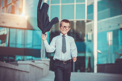 Kid businessman is waving his jacket Royalty Free Stock Photos