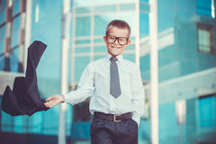 Kid businessman is waving his jacket Stock Image