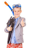 Kid businessman wearing fins, snorkel and goggles Royalty Free Stock Photo