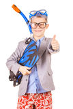 Kid businessman wearing fins, snorkel and goggles Royalty Free Stock Photography