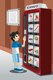 Kid buying candy from a vending machine Stock Photography