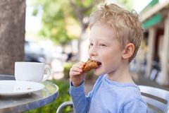 Kid in cafe Royalty Free Stock Photo