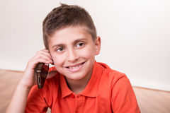Kid calling with smartphone Stock Photo