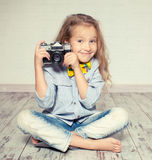 Kid with camera. Stock Photos