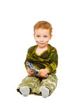 Kid in camouflage uniform with a gun Royalty Free Stock Photo