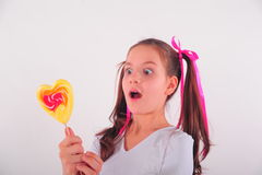 Kid with candy Stock Image
