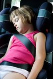 Kid in a car seat. Little girl sleeping in safety car seat Stock Image
