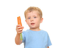 Kid and carrot Royalty Free Stock Images