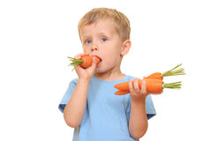 Kid and carrot Stock Images