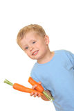 Kid and carrot Royalty Free Stock Image