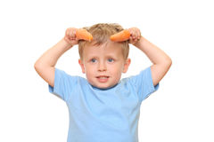 Kid and carrot Stock Photo