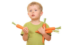 Kid and carrot Stock Image