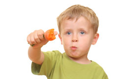 Kid and carrot Royalty Free Stock Photo