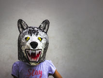 Kid with carton wolf mask stock image