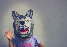 Kid with carton wolf mask royalty free stock image