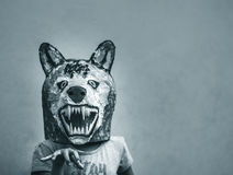 Kid with carton wolf mask. Photograph of a kid with a carton wolf mask royalty free stock photography