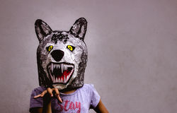 Kid with carton wolf mask royalty free stock photography
