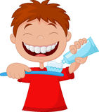 Kid cartoon squeezing tooth paste on a toothbrush Stock Images