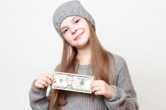 Kid and cash Stock Photos