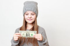 Kid and cash Stock Images