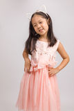 Kid with Cat Ear Headband in Pink Dress, Isolated on White Royalty Free Stock Photo