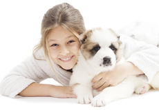 Kid and Caucasian Shepherd puppy Stock Images