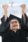 Kid celebrating diploma Royalty Free Stock Photography