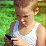 Kid with Cellphone Stock Photography