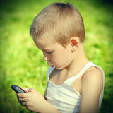 Kid with Cellphone Royalty Free Stock Image
