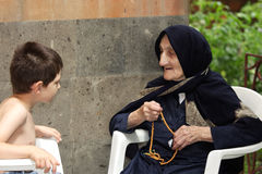Kid chatting with granny Stock Photo
