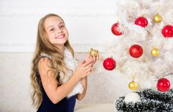 Kid cheerful excited about new year coming. Family holiday concept. Small girl wear velvet dress feels festive near. Christmas tree. Christmas very special time stock photo