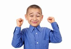 Kid cheering. Kid with fists raised in success, isolated Stock Images