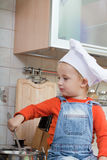 Kid in a chef cap Royalty Free Stock Photo