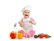 Kid in chef hat with healthy food Stock Images