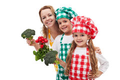 Kid chefs helping their mother preparing healthy food Royalty Free Stock Photography