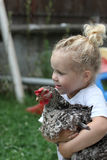 Kid and chicken royalty free stock photos