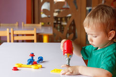 Kid child boy playing with toys Stock Image