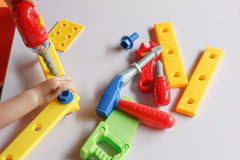 Kid child boy playing with toys Royalty Free Stock Photos