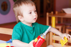 Kid child boy playing with toys Royalty Free Stock Photography