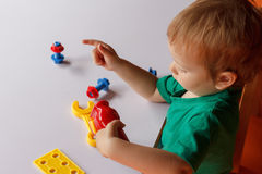 Kid child boy playing with toys Royalty Free Stock Image