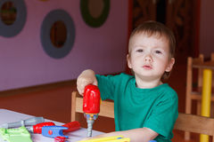 Kid child boy playing with toys Stock Photography
