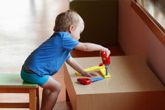 Kid child boy playing with toys Stock Photos