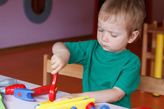 Kid child boy playing with toys Royalty Free Stock Photo