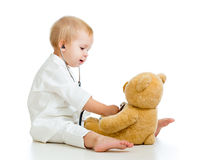 Kid child with clothes of doctor and teddy bear Royalty Free Stock Images