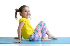 Child doing fitness exercises Royalty Free Stock Images
